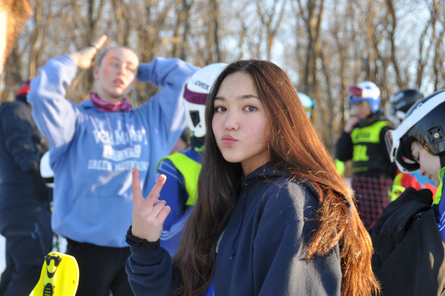 Rachel with the infamous hand gesture| JV Championships